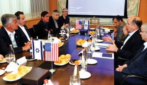 Israel's Defense Minister Moshe Yaalon (right, speaking) addresses the New York delegation at the Kirya building in Tel Aviv.