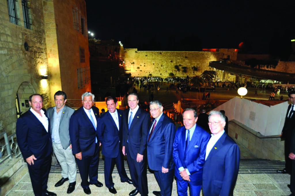 Gov. Andrew Cuomo leads a New York delegation — including Senate co-leaders Dean Skelos and Jeff Klein, and Assembly Speaker Sheldon Silver — in Yerushalayim Wednesday night, as they visit the Kosel. (Office of the Governor)