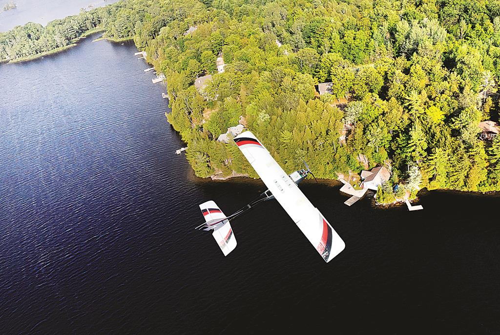 A drone flies over water, which will be a familiar sight over central New York in the coming weeks. (AP Photo/PrecisionHawk)