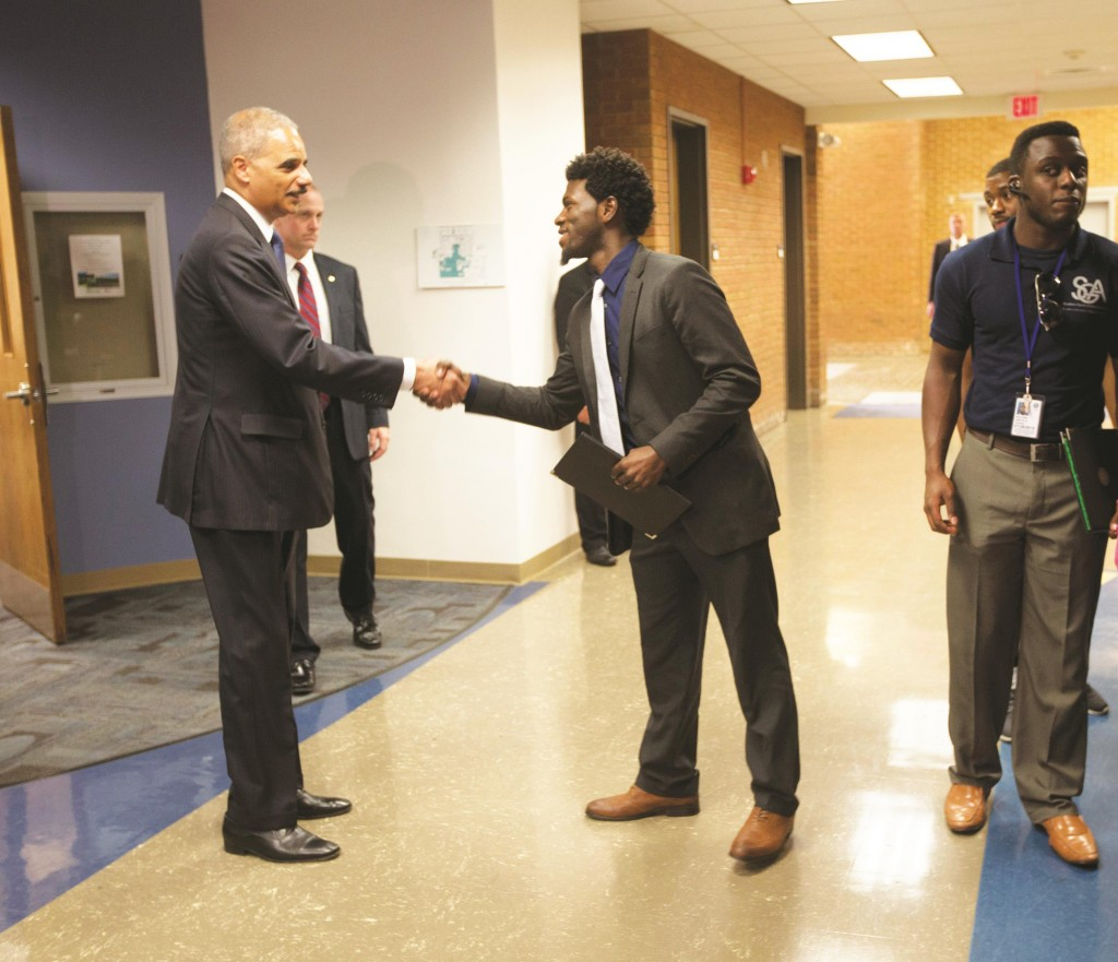 Attorney General EricHoldershakes hands with Bradley J. Rayford, 22 following his meeting at St. Louis Community College Florissant Valley in Ferguson, Mo., Wednesday (AP Photo/Pablo Martinez Monsivais, Pool)