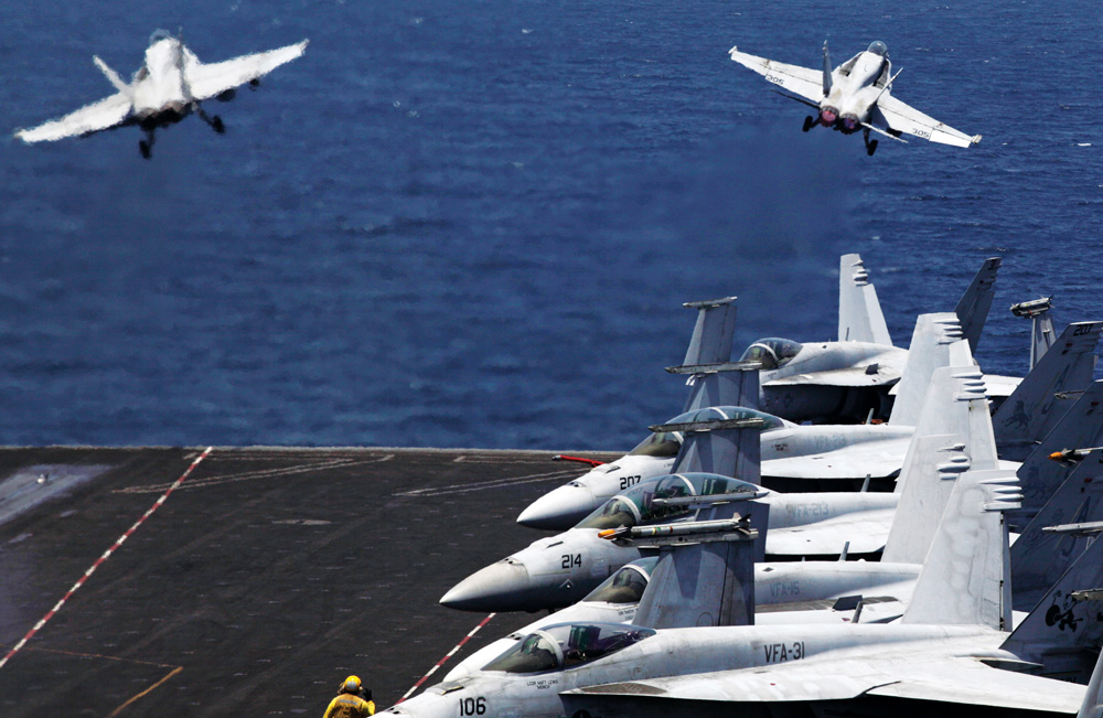 U.S. fighter jets take off for mission inIraqfrom the flight deck of the U.S. Navy aircraft carrier USS George H.W. Bush, in the Persian Gulf, Monday.  (AP Photo/Hasan Jamali)