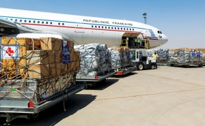 Airport employees unloading humanitarian freight from a French Air Force plane at Erbil airport in Iraqi Kurdistan, Sunday (AP Photo/Jerome Bardenet)
