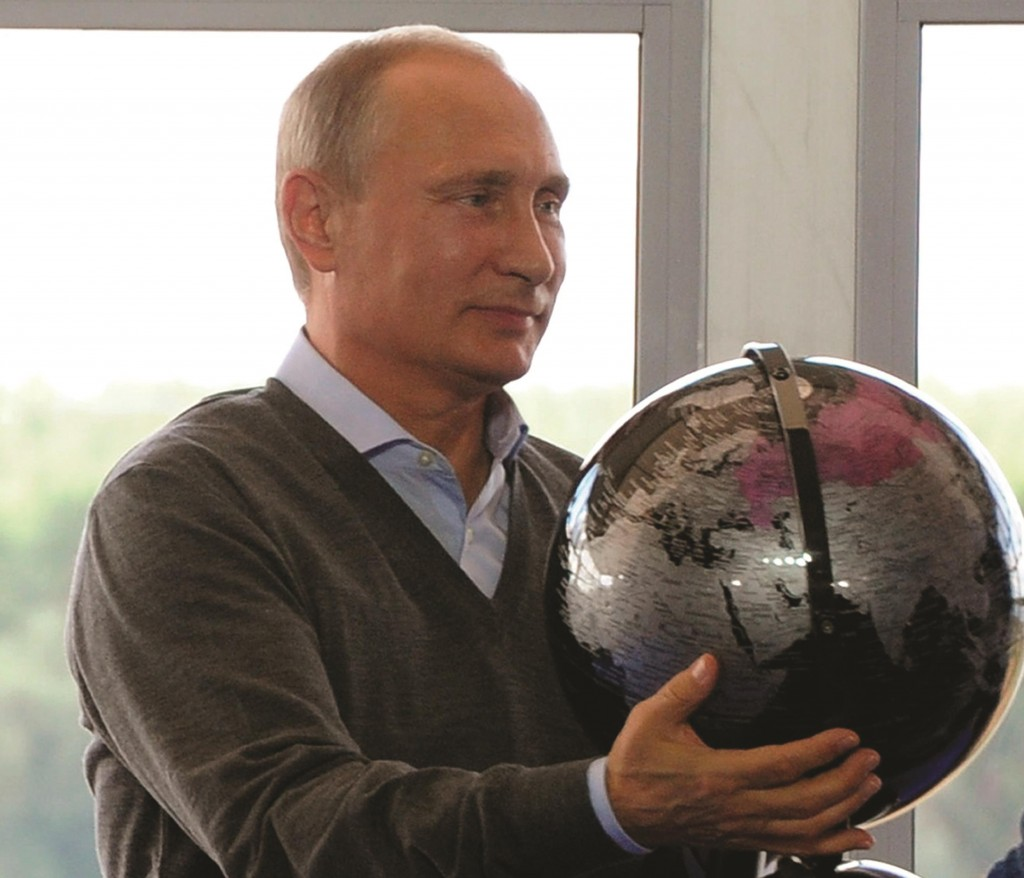 Russian President Vladimir Putin holds a terrestrial globe presented to him as a gift during his meeting with participants in the youth educational forum at the Seliger youth camp near Lake Seliger, some 450 kilometers northwest of Moscow. (Novosti, Mikhail Klimentyev, Presidential Press Service)