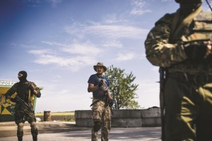 Ukrainian soldiers stand guard at a checkpoint on a road near the city of Dnepropetrovsk. (DIMITAR DILKOFF/AFP/Getty Images)