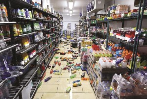 Cans and bottles litter the floor of cold box at a 7-Eleven. (AP Photo/Rich Pedroncelli)