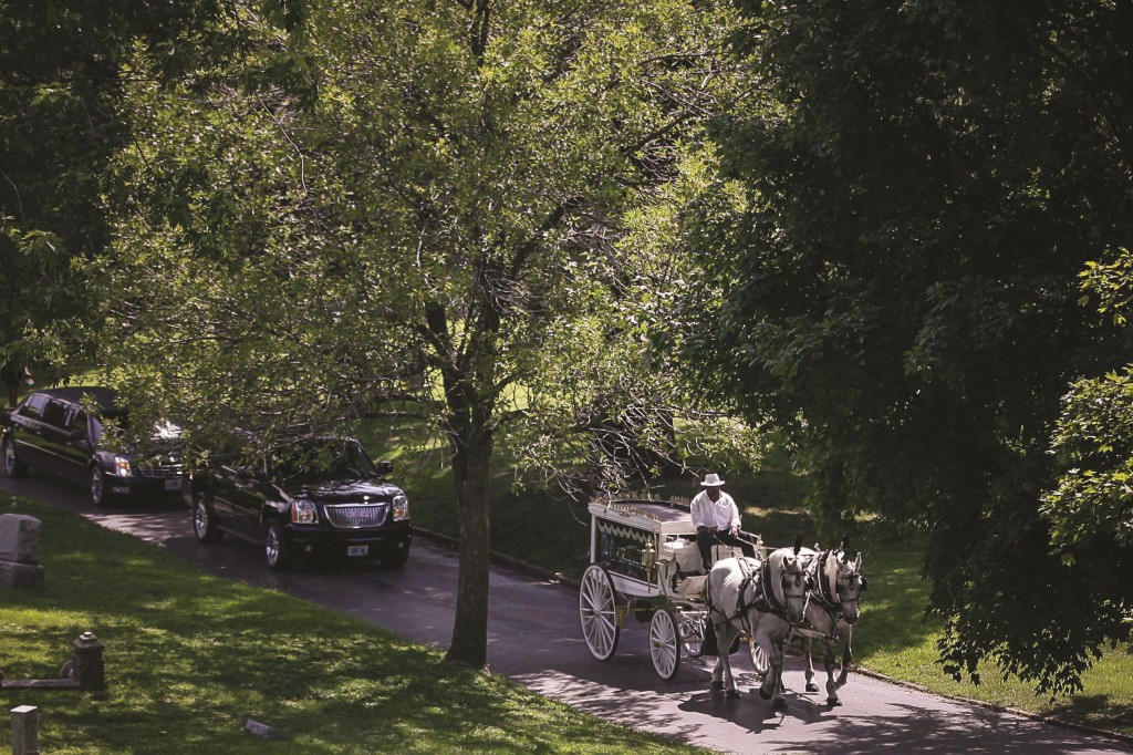 The casket containing the body of Michael Brown is transported by horse carriage as it is taken to its final resting place in St. Peter's Cemetery located in St. Louis, Missouri. (REUTERS/Joshua Lott)