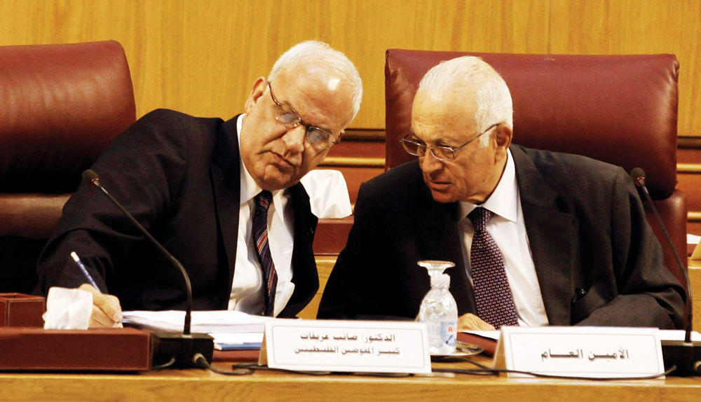 Palestinian chief negotiator Saeb Erekat (L) talks with Arab League Chief Nabil el-Araby during their meeting at the Arab League in Cairo on Monday. (REUTERS/Asmaa Waguih)