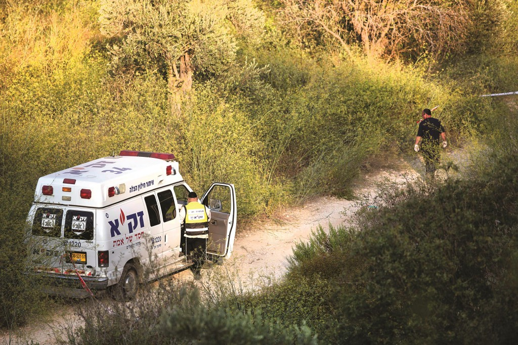 """A ZAKA unit seen near the Jerusalem Forest where Aharon Sofer, z""""l (inset), was found on Thursday during a massive search.  (Yonatan Sindel/Flash90)"""