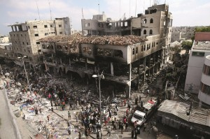 The scene after an Israeli strike in the southern Gaza Strip on Sunday. (AP Photo/Eyad BabaAP Photo/Eyad Baba)