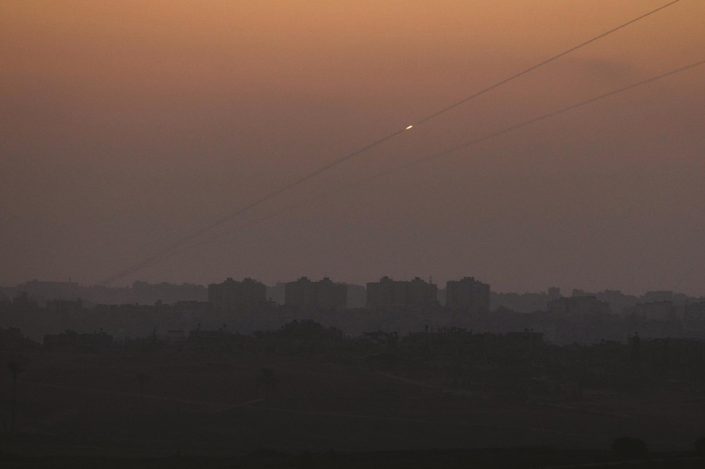 A rocket is seen from Sderot as it is fired from the northern Gaza Strip toward Israel late Sunday. (REUTERS/ Ronen Zvulun)
