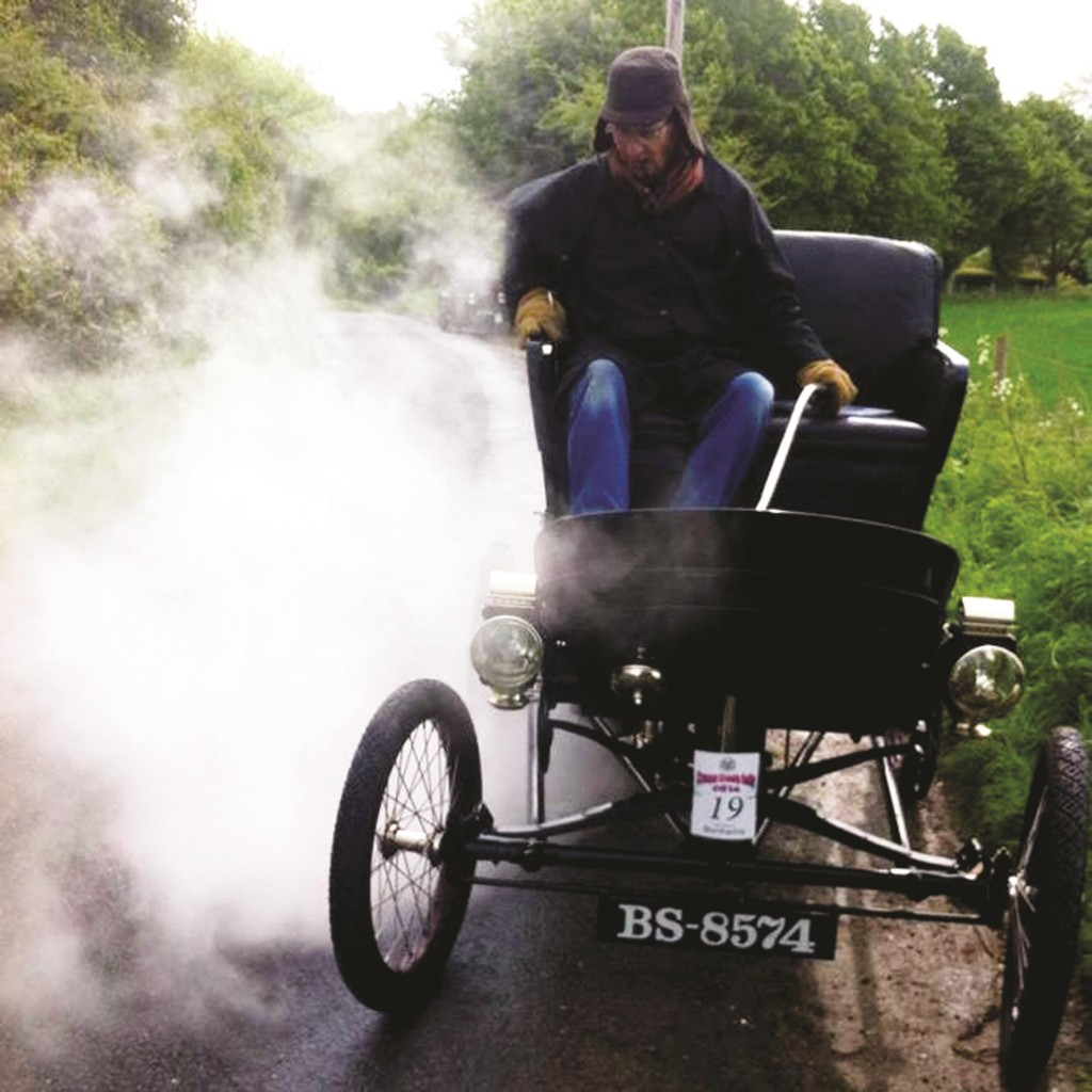 Nick Howell rides his Toledo Steam Car in Oxford, England. Howell and his brother, Chris, are poised to move full steam ahead Tuesday, Aug, 26, 2014 in re-creating a drive from Flagstaff to the Grand Canyon that was first undertaken in 1902. They will be riding in the Toledo Steam Car they spent more than eight years restoring.  (AP Photo/Courtesy of Nick and Chris Howell)
