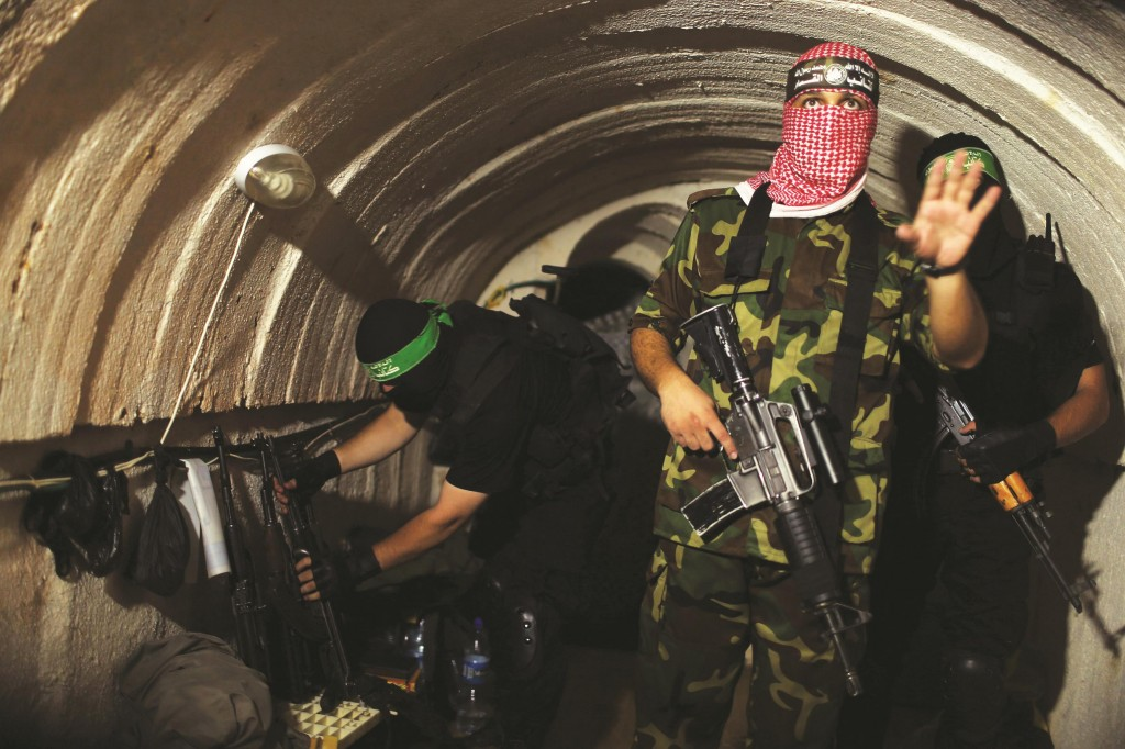 A Palestinian terrorist from the Izz el-Deen al-Qassam Brigades, the armed wing of Hamas, inside an underground tunnel in Gaza in a rare tour with a Reuters reporter, photographer and cameraman. (REUTERS/Mohammed Salem)