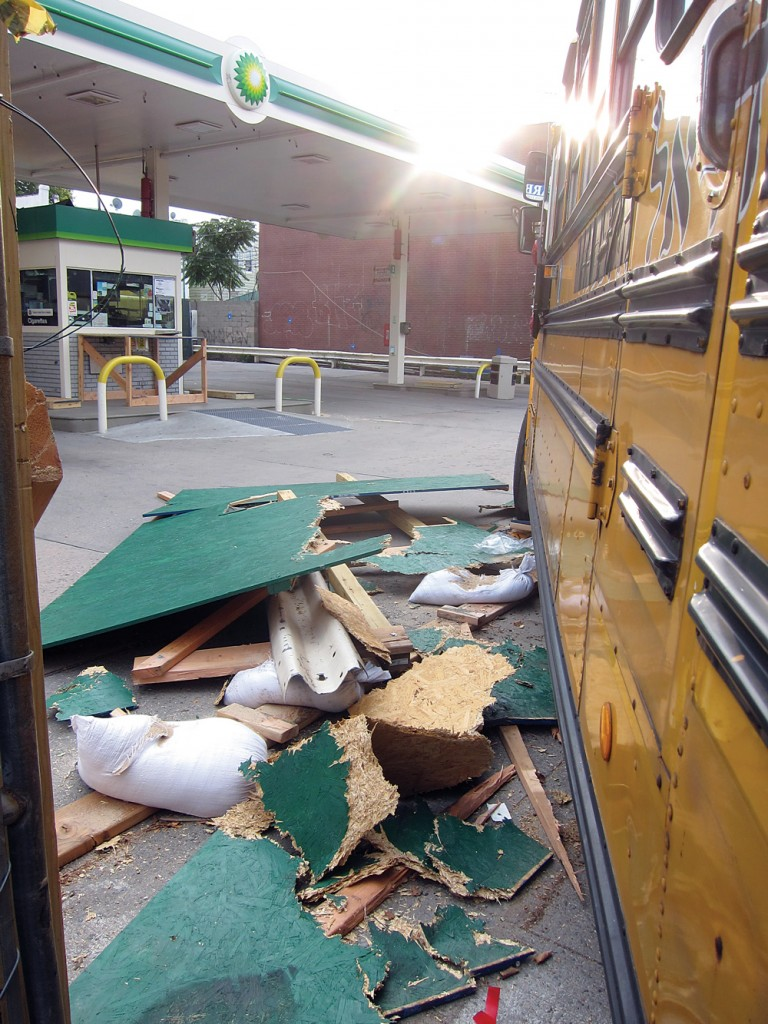 The scene at the boarded-up gas station, where the quick-thinking driver guided the bus to make it stop.