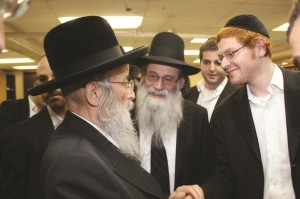 """Aaron Sofer, z""""l, with Harav Binyamin Eisenman, his Rosh Yeshivah and his uncle, greeting Harav Tuvia Weiss, Gaavad of Yerushalayim when he visited Rav Eisenman's yeshivah in Lakewood. (The Voice of Lakewood)"""