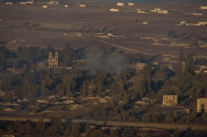 Smoke rises near a U.N. post in the Quneitra province as Syrian rebels clash with President Bashar Assad's forces, as seen from the Golan Heights, Wednesday. (AP Photo/Ariel Schalit)