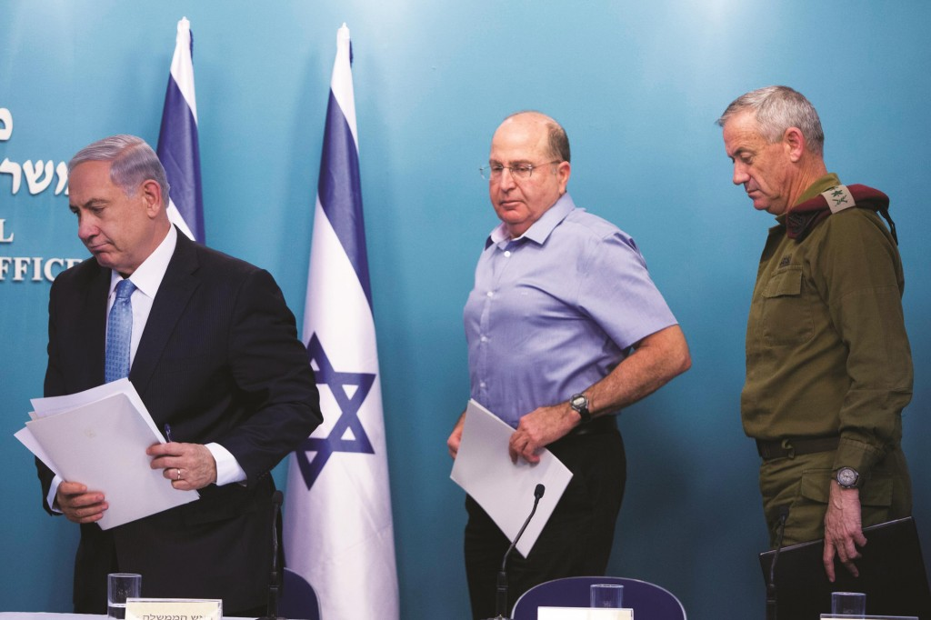 Israeli Prime Minister Binyamin Netanyahu (L), Minister of Defense Moshe Yaalon (C) and IDF Chief of Staff Benny Gantz (R) seen at a press conference on Tuesday night. (Yonatan Sindel/Flash90 )