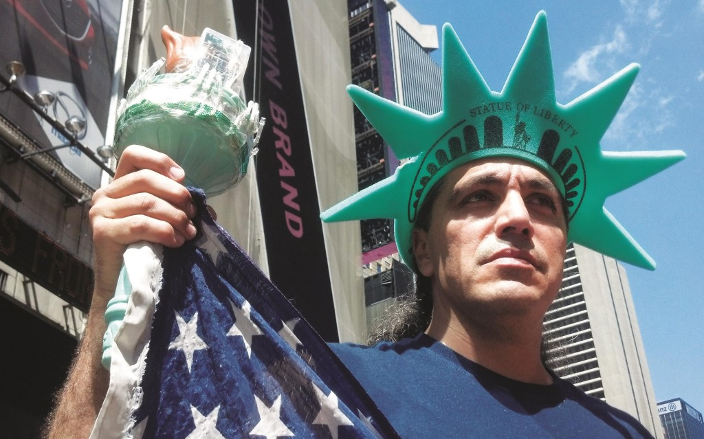 Bonny Muneca, a costumed Statue of Liberty, on Tuesday protest a police crackdown. (AP Photo/Verena Dobnik)