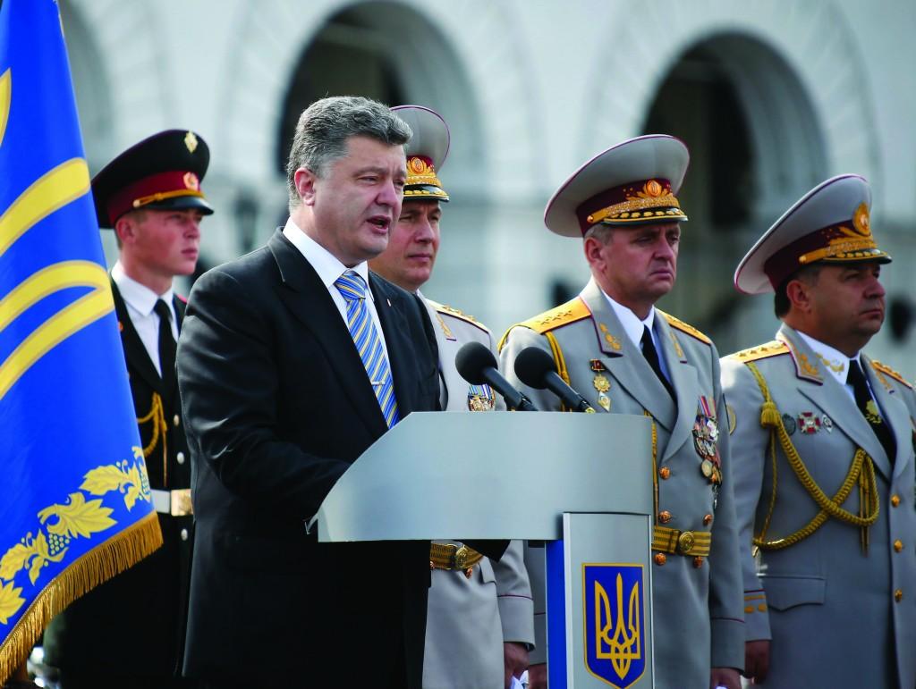 Ukraine's President Petro Poroshenko speaks during Independence Day celebrations in Kiev, Sunday. On Monday, Poroshenko dissolved Parliament, paving the way for early elections.  (REUTERS/Gleb Garanich)
