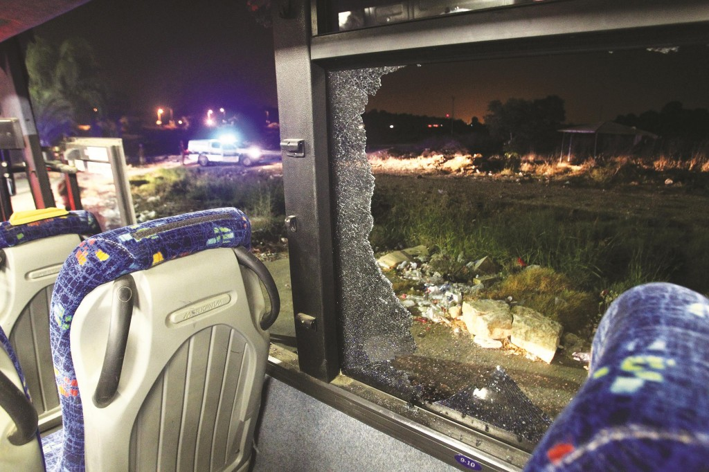 A bus window is shattered Tuesday by a rocket fired from Gaza that hit near Kibbutz Yad Mordechai.  (DAVID BUIMOVITCH/AFP/Getty Images)
