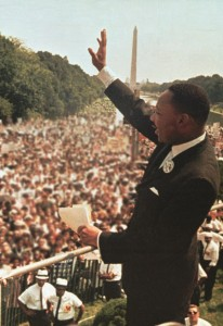 "Dr. Martin Luther King Jr. acknowledges the crowd at the Lincoln Memorial for his ""I Have a Dream"" speech during the March on Washington. (AP Photo/File)"