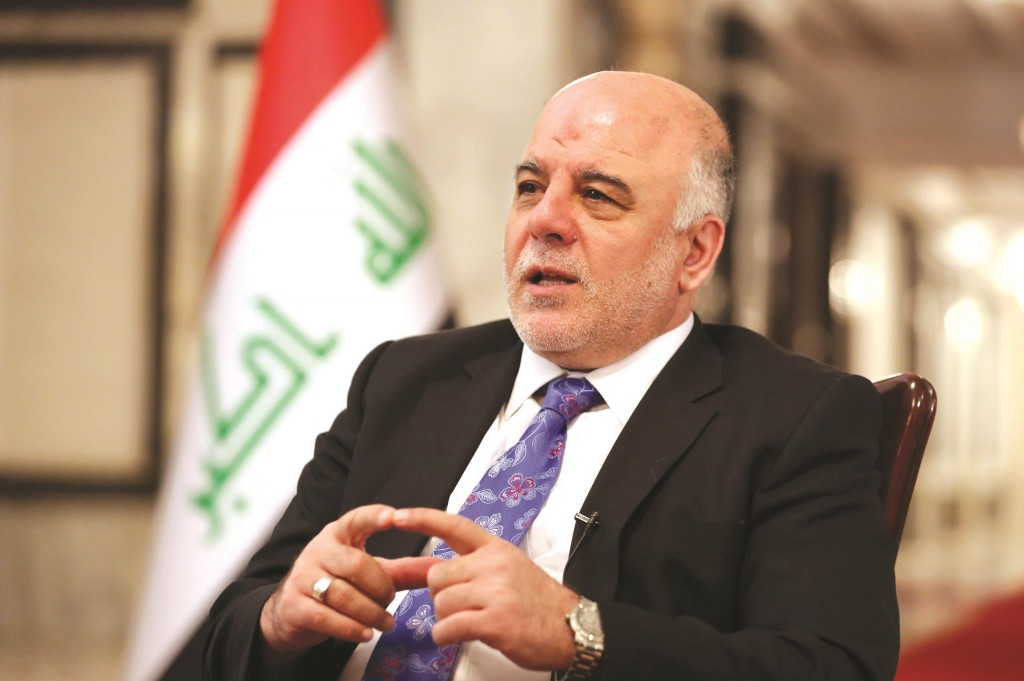 Iraq's Prime Minister Haideral-Abadispeaks during an interview with The Associated Press in Baghdad, Iraq, Wednesday. Iraq's new prime minister says foreign ground troops are neither necessary nor wanted in his country's fight against the Islamic State group.  (AP Photo/Hadi Mizban)
