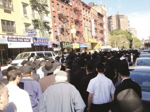 The procession of the levayah down East Broadway on the Lower East Side.