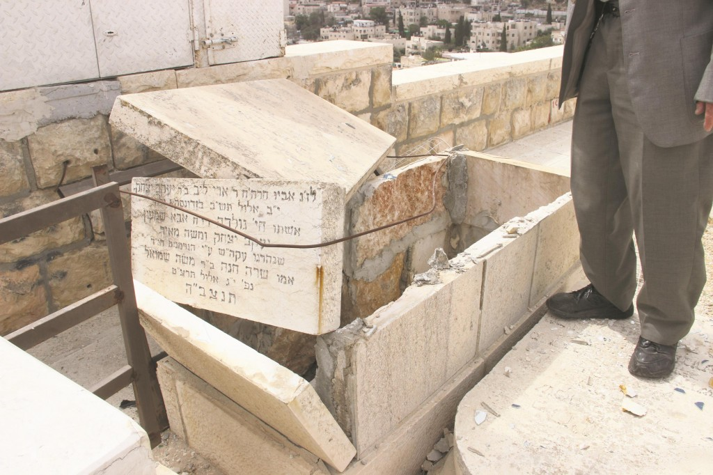 """One of the more than 40 graves vandalized in the Kolel Polin Section of Har Hazeisim, next to the maarah where the Beis Yisrael and the Lev Simchah, zy""""a, of Gur, are buried."""