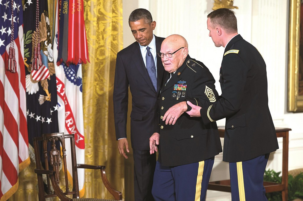President Barack Obama, left, escorts retired Army Command Sgt. Maj. Bennie G. Adkins before presenting him with the Medal of Honor, in the East Room of the White House, on Monday, in Washington. (AP Photo/Evan Vucci)