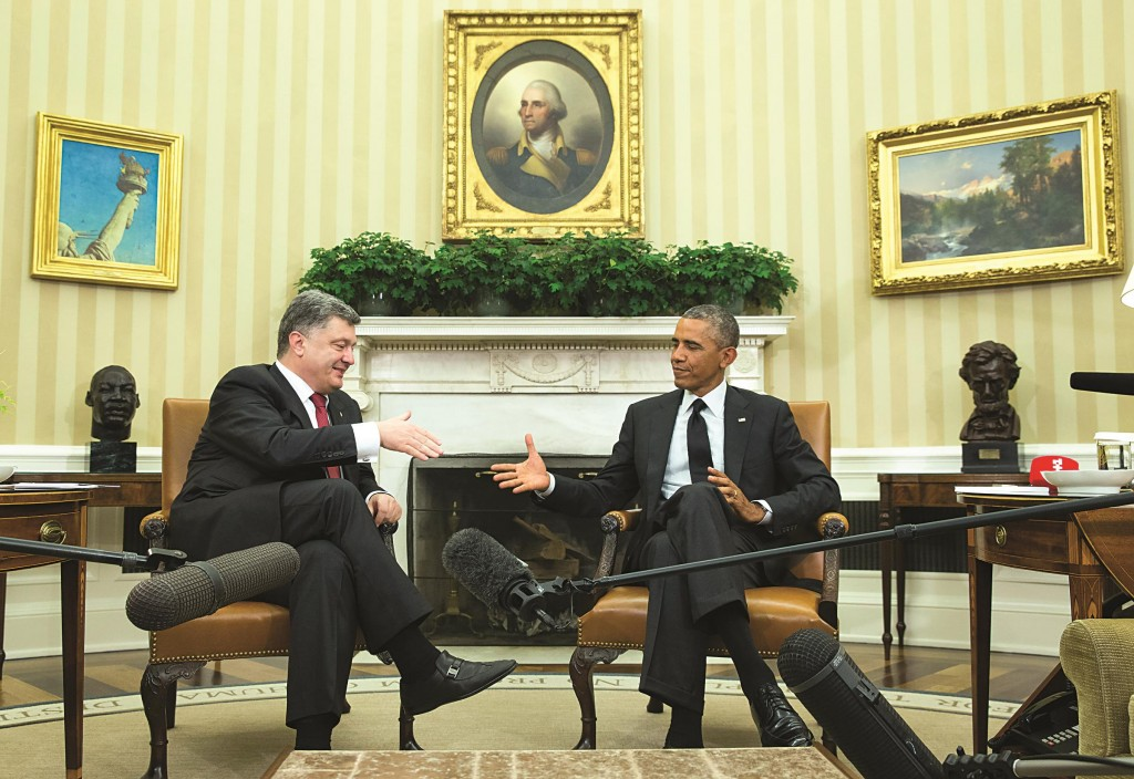 President Barack Obama shakes hands with Ukrainian President Petro Poroshenko after a meeting in the Oval Office of the White House, on Thursday in Washington.  (AP Photo/Evan Vucci)