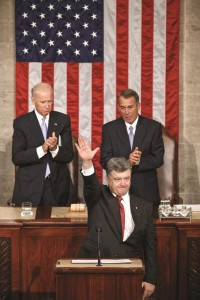 Ukrainian President Petro Poroshenko, joined by Speaker of the House John Boehner, and Vice President Joe Biden, waves after addressing a joint meeting of Congress, at the Capitol in Washington, Thursday. (AP Photo/J. Scott Applewhite)