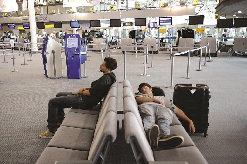 Travelers wait for a flight at the Marseille-Provence airport on Monday in Marignane. (BORIS HORVAT/AFP/Getty Images)