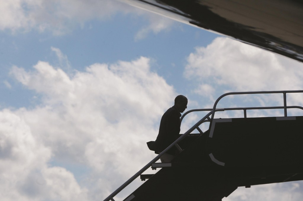 President BarackObamaboards Air Force One as he departs General Mitchell International Airport in Milwaukee, Monday. (AP Photo/Charles Dharapak)