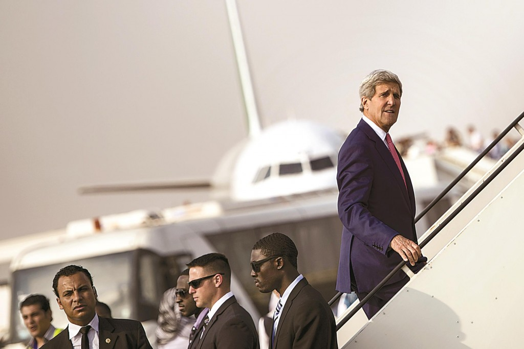 """Secretary of State John Kerry boards his plane at Cairo International Airport on Sunday as he leaves the Egyptian capital. Kerry described Egypt as an """"important partner"""" during a short stop in Cairo to build support against the Islamic State group in Iraq and Syria.  (AP Photo/Brendan Smialowski)"""