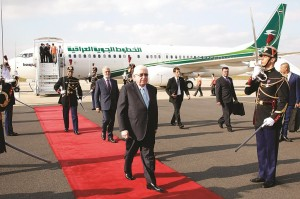 Iraq President Fouad Massoum (C) followed by Iraq Foreign Minister Ibrahim Al-Jaafari (L), arrive with Iraqi officials at Orly airport south of Paris, France, Sunday, ahead of a conference with Secretary of State John Kerry, French President Francois Hollande and diplomats from around the world.  (AP Photo/Francois Mori)