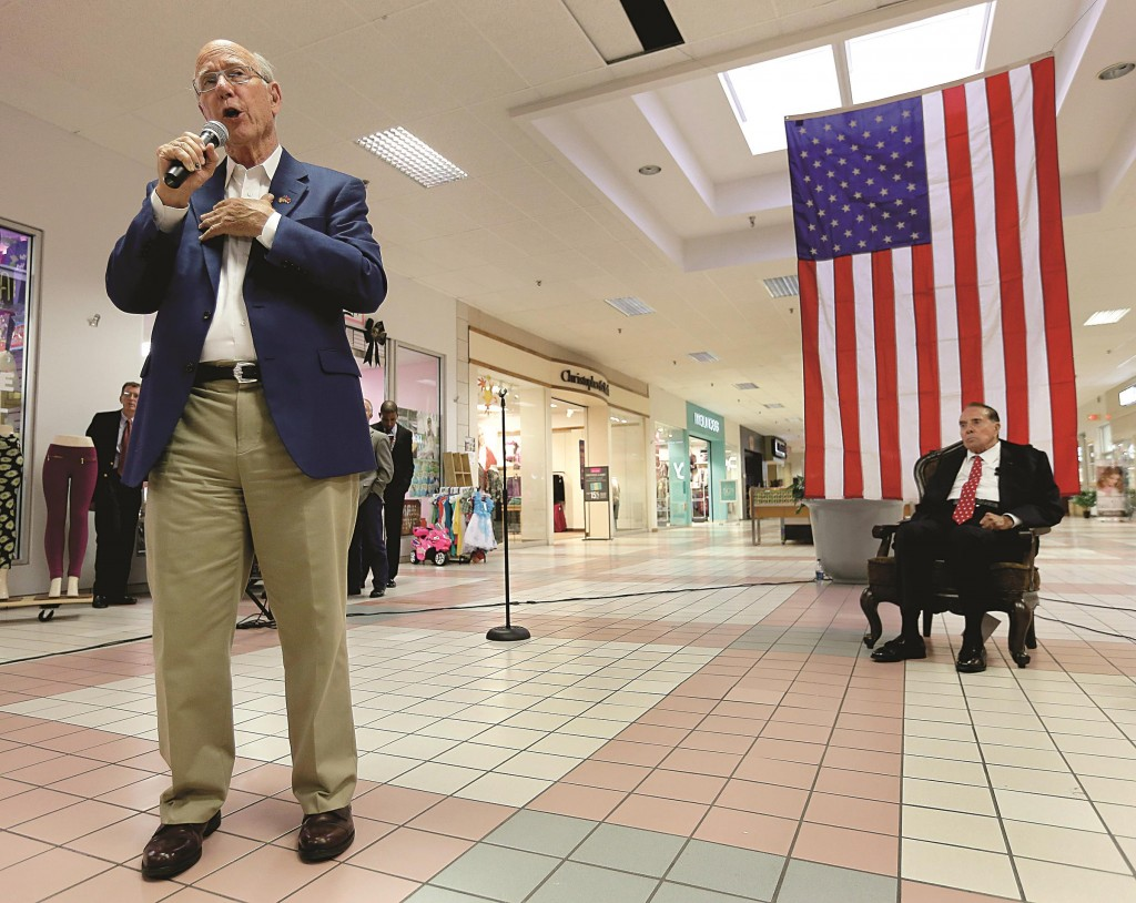 Former Senate Majority Leader Bob Dole (R) listens whileRepublicanSen. Pat Roberts speaks during a campaign stop at a mall in Dodge City, Kan., Monday. Three-term incumbent Roberts is facing a challenge from independent candidate Greg Orman.  (AP Photo/Charlie Riedel)
