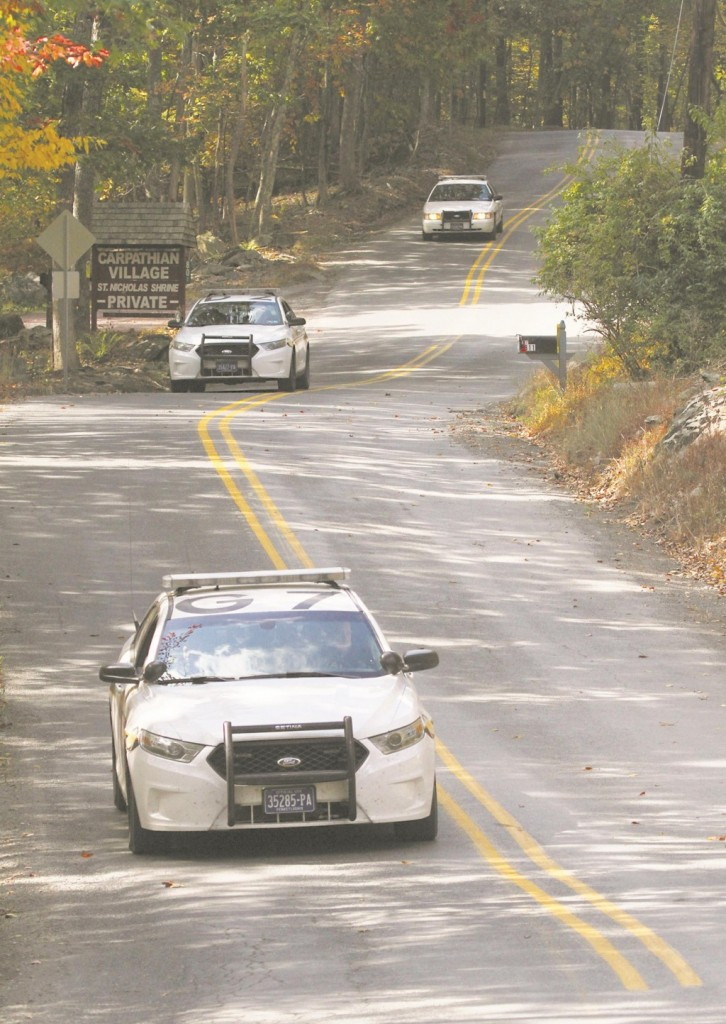 Three Pennsylvania State Police cars patrol along Snow Hill Road in Price Township, Pa, Tuesday, as the search for suspected killer Eric Frein carries on for the 18th day.  (AP Photo/Scranton Times-Tribune, Michael J. Mullen)