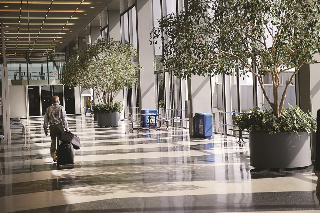 Stranded passengers pass through a deserted area of O'Hare International Airport in Chicago, Illinois. (Scott Olson/Getty Images)