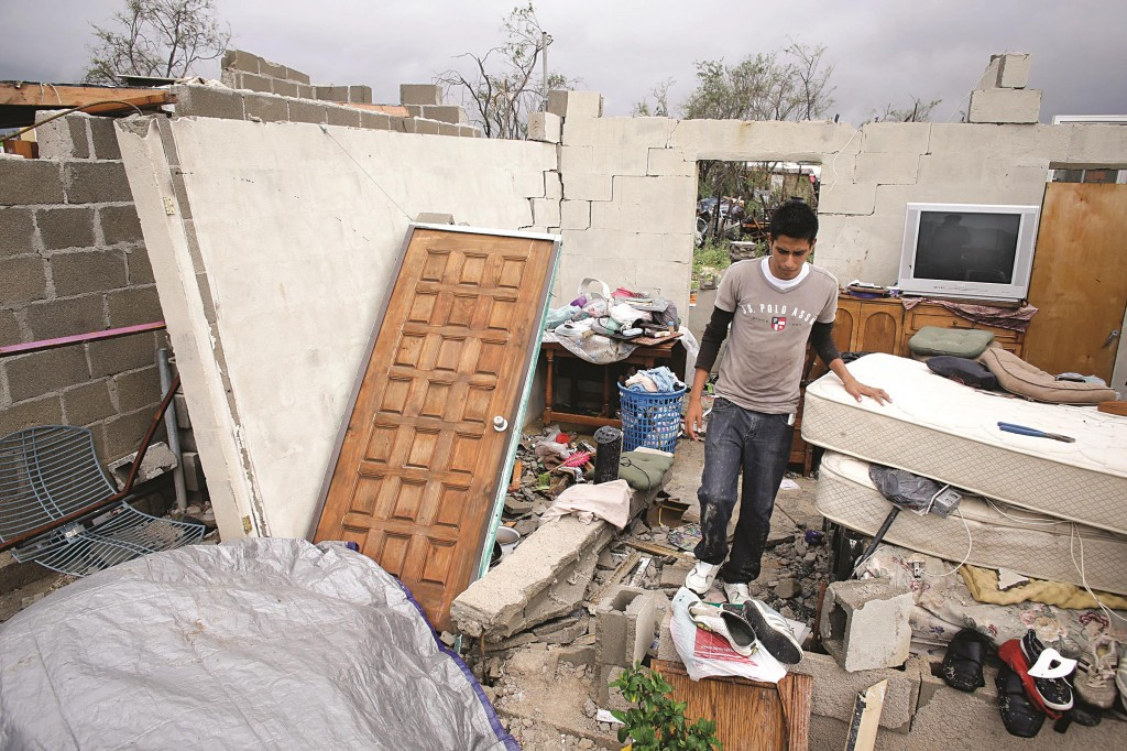 Raimundo Diaz, 17, walks inside what it used to be a bedroom after his family's house was destroyed by Hurricane Odile in Los Cabos, Mexico, Monday. (AP Photo/Victor R. Caivano)