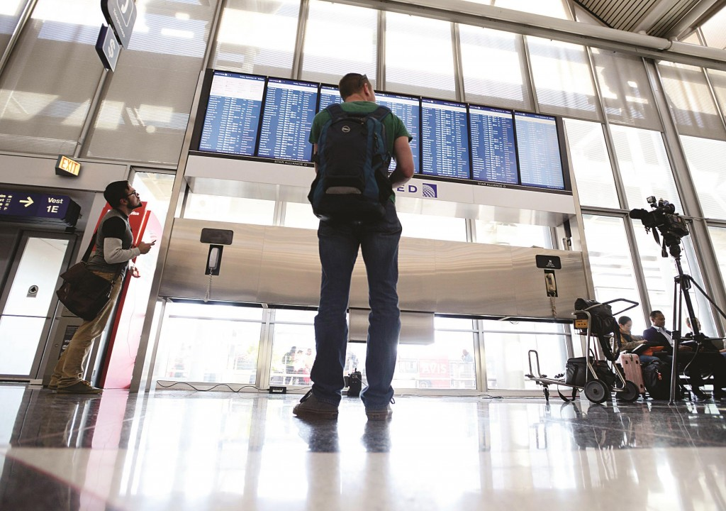 Dennis McCormack of Rockaway, N.J., checks the departure board only to find out that his flight to Newark, N.J. has been canceled at O'Hare International Airport in Chicago. (AP Photo/Paul Beaty)