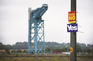 """""""Yes"""" and """"No"""" campaign placards adorn a post in the sight of the former John Brown's shipyard on the River Clyde in Glasgow, Scotland. (Peter Macdiarmid/Getty Images)"""