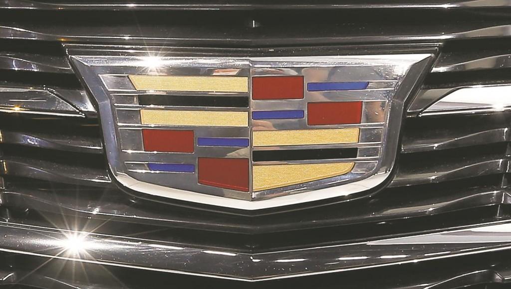 This Jan. 2014 file photo shows Cadillac's logo on the 2015 ATS coupe at its Detroit debut. (AP Photo/Paul Sancya, File)