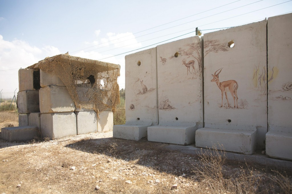 An army outpost and a concrete protection wall are seen at Kerem Shalom Kibbutz in southern Israel, along the border with the Gaza Strip.  (MENAHEM KAHANA/AFP/Getty Images)