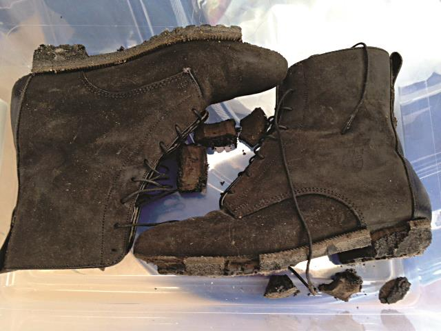 A pair of boots with melted soles that Carol Orazem wore while working at the World Trade Center on 9/11. (AP Photo/Carol Orazem)