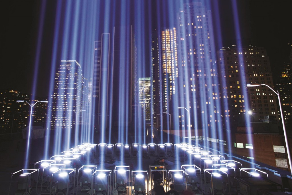 The Tribute in Light on Monday rises from behind the reflecting pool at the 9/11 Memorial. Thursday marks the 13th anniversary of the 2001 terror attacks. (AP Photo/Mark Lennihan)