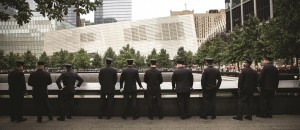 Law enforcement officers pay respects to their fallen colleagues at South Tower Pool. (AP Images)