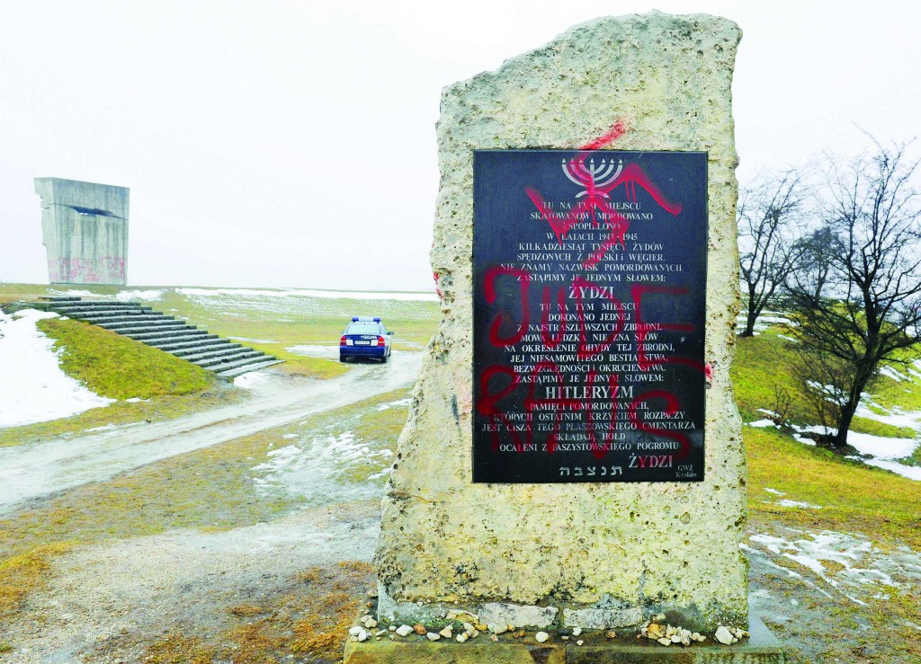 A Holocaust memorial, in the background on the left, and a smaller plaque in the foreground, in Plaszow, Poland, were sprayed with anti-Semitic graffiti in 2010. Some are tempted to disregard the low number of anti-Israel and anti-Semitic demonstrations in Poland, but they may not realize that Poland is notorious for low turnout at events of political importance. Hence even small numbers are relevant. (AP Photo/str)