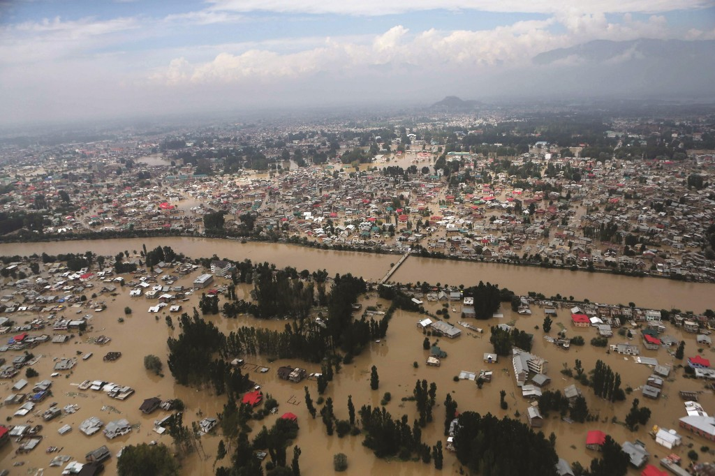 An aerial view shows buildings submerged in floodwaters in Srinagar, in Indian Kashmir, Tuesday. (AP Photo/Dar Yasin)