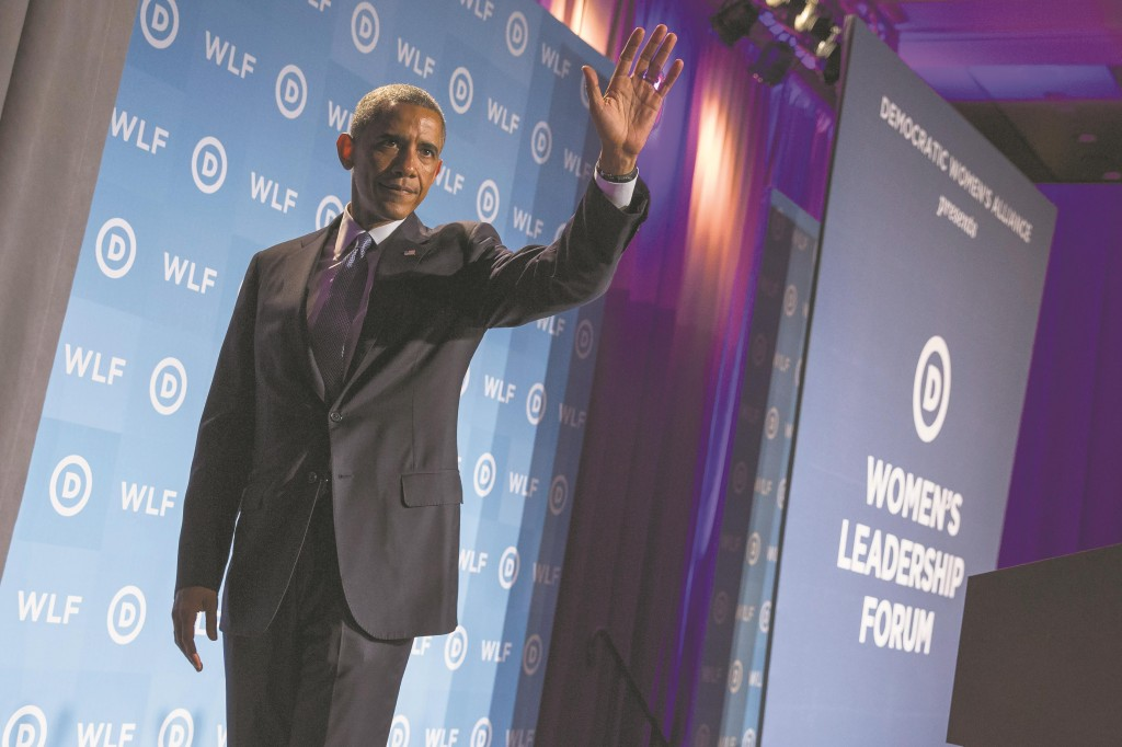 President Barack Obama waves after delivering remarks at the Democratic National Committee's Women's Leadership Forum, on Friday, in Washington. (AP Photo/Evan Vucci)