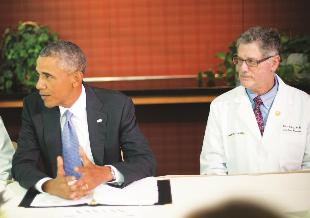 President Barack Obama (L) talks during a meeting with Emory University doctors and healthcare professionals at the CDC in Atlanta, Tuesday. (AP Photo/Pablo Martinez Monsivais)