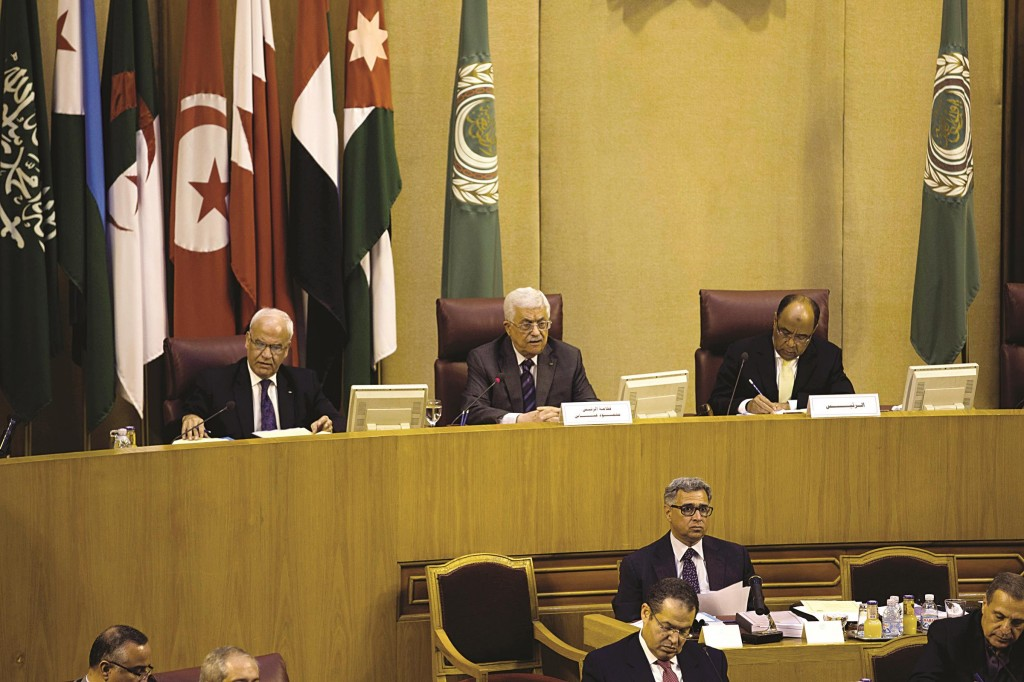Palestinian President Mahmoud Abbas, center, speaks during an Arab foreign ministers meeting at the Arab League headquarters in Cairo, Egypt. (AP Photo/Hassan Ammar)